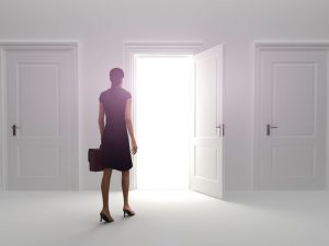 11783990 - door to success, business female choosing the entrance to an open door.